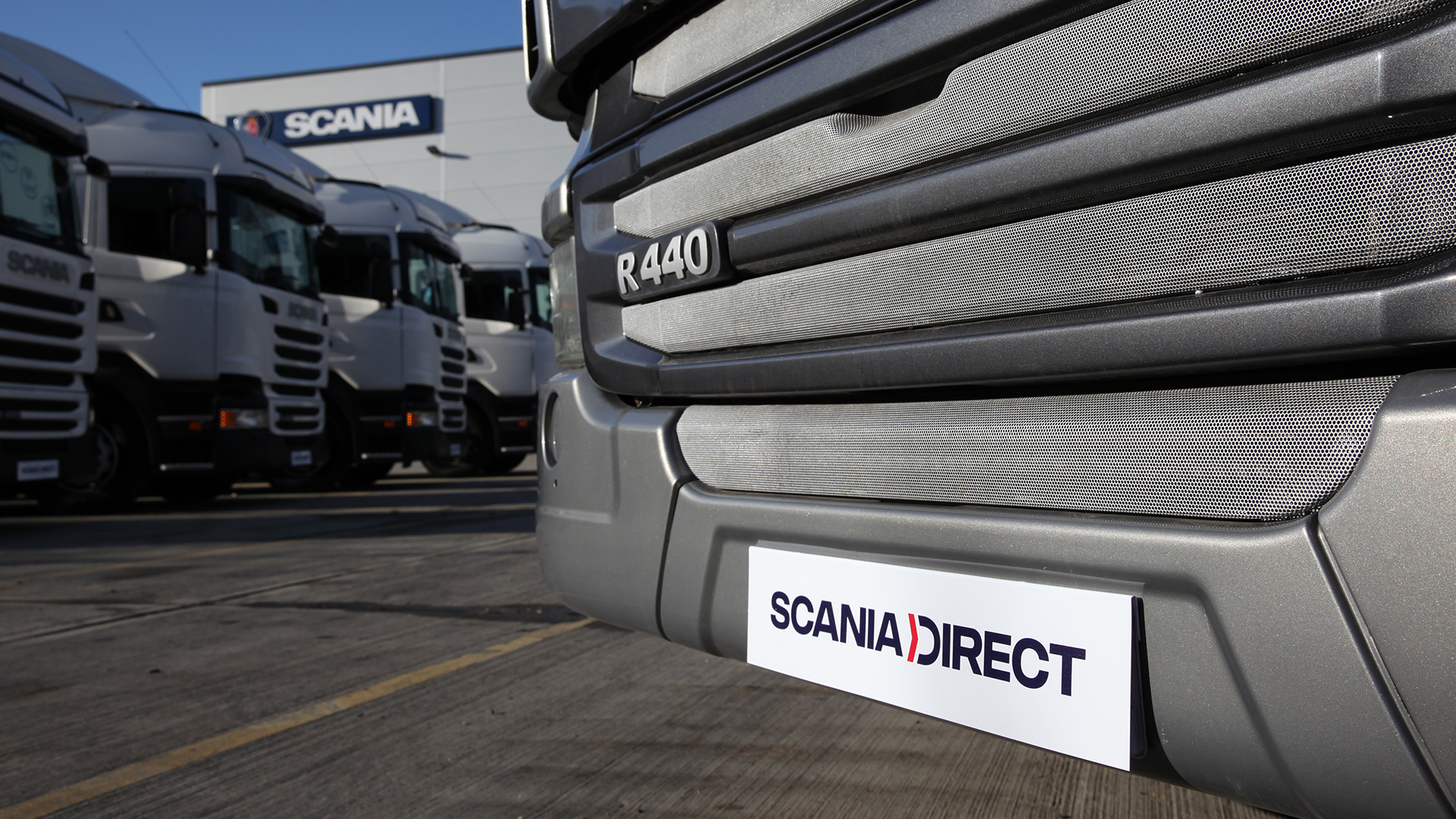 Close up of registration plate with Scania Direct on